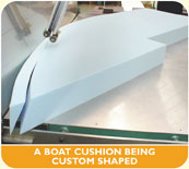 A boat cushion being custom shaped